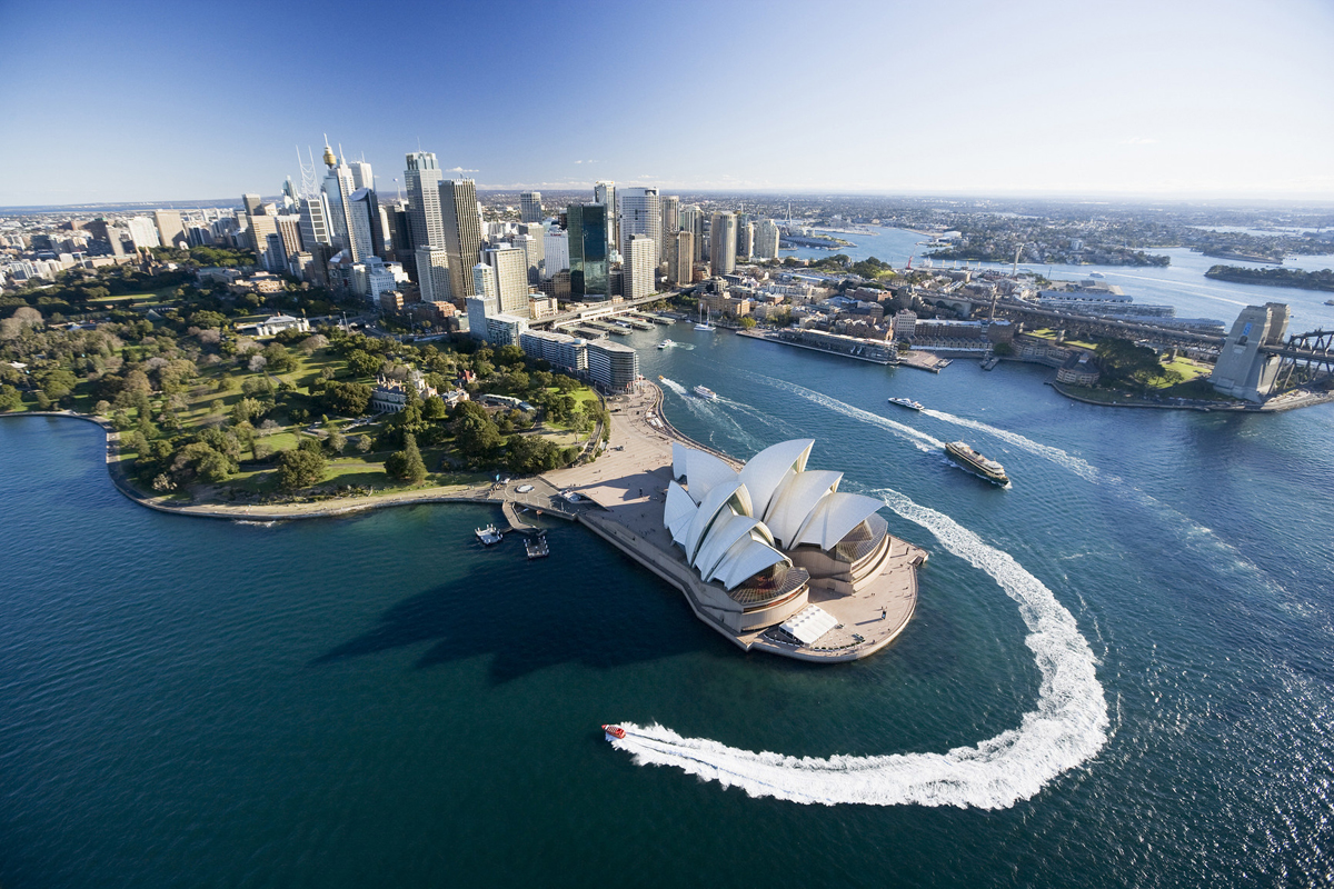 Aerial of Sydney and the Harbour foreshore including Opera House. Jet boat tours in foreground